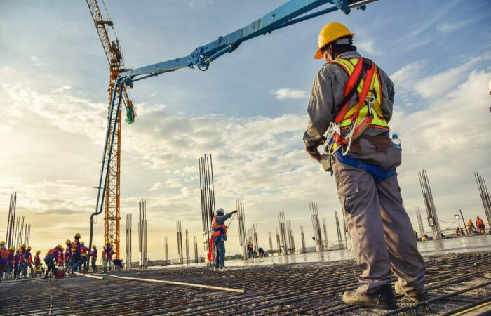 construction-workers-using-machinery-1200