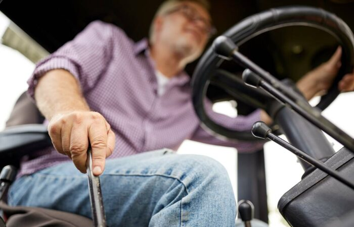 farmer-driving-tractor-he-bought-1200
