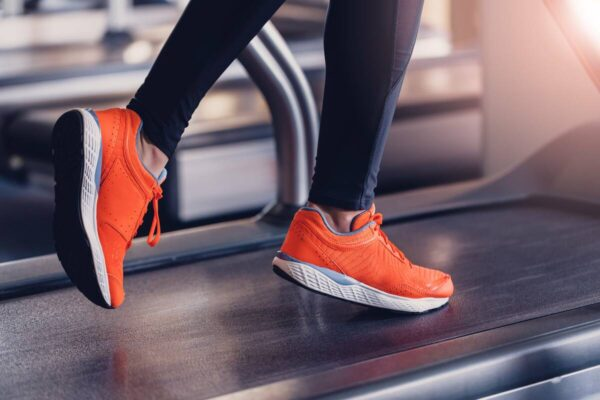 person-running-on-leased-treadmill-1200