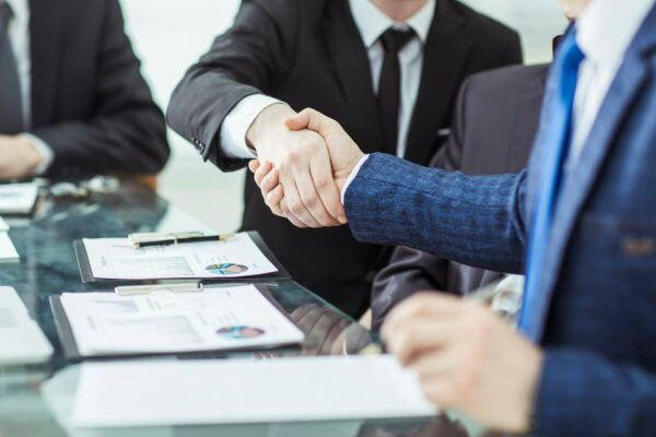 unsecured business loans shaking hands